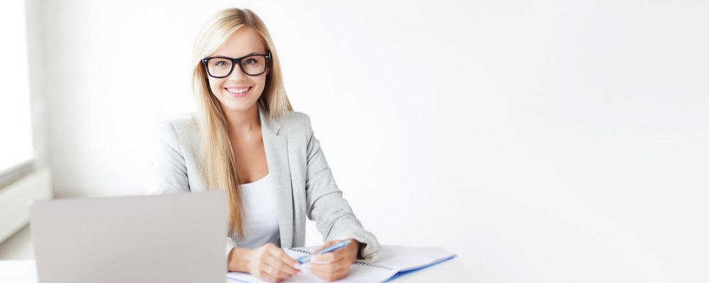 business and education concept - indoor picture of smiling woman with documents and pen